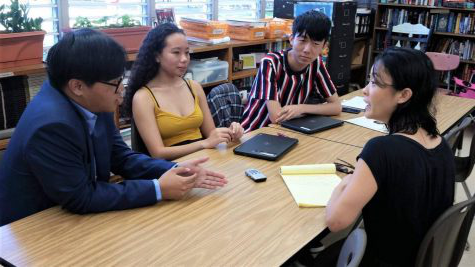 Pinion editors from the 2019 staff, Kelvin Ku, Alexandria Buchanan, and Thompson Wong interview a Civil Beat reporter.